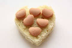 Bread heart with sausage. Royalty Free Stock Photo