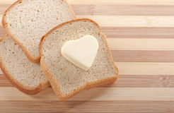 Bread and heart shaped butter Royalty Free Stock Photography