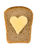 Bread and heart shaped cheese Stock Photography
