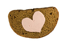 Bread and heart shaped sausage Stock Photo