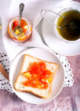 Bread and herb tea Stock Images