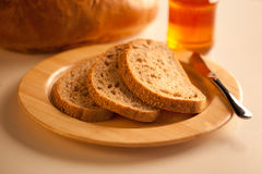 Bread with honey Royalty Free Stock Photography