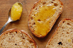Bread with honey Stock Images