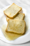 Bread with honey Royalty Free Stock Photos