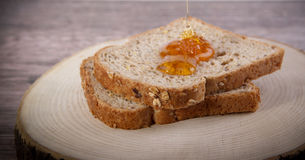 Bread Honey andwood background. Bread Honey Concept and Decoration Royalty Free Stock Photos