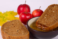 Bread, honey and apples Stock Images