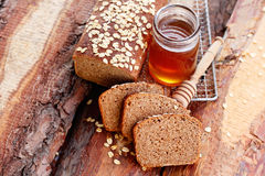 Bread with honey and oats Stock Photos