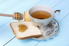 Bread with honey Paste with a drink stock photo