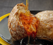 Bread with honey Stock Photo