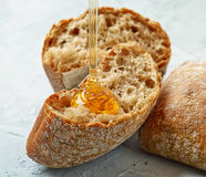 Bread with honey Royalty Free Stock Image