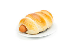 Bread with hot dog on white dish. Bread with hot dog on white dish isolated Royalty Free Stock Photography