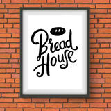 Bread House Bakery Sign on Red Brick Wall Royalty Free Stock Photography