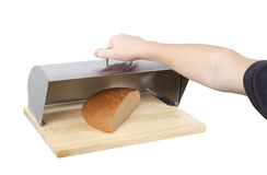 Bread. Human hand is opening metal box with piece of bread inside Stock Photo