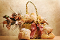 Bread inside basket with magnolia flowers Stock Photography