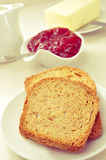 Bread, jam and butter Royalty Free Stock Photography