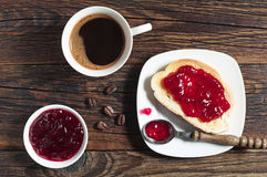 Bread with jam and coffee cup Stock Photography