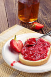 Bread with jam and cup of tea Royalty Free Stock Photo