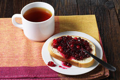 Bread with jam and cup of tea Stock Photos