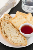 Bread with jam and glass Royalty Free Stock Image