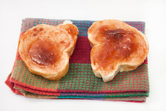 Bread with jam on a kitchen towel Stock Photo