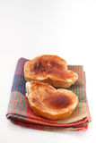 Bread with jam on a kitchen towel Royalty Free Stock Photo