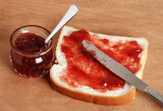 Bread and jam with knife Stock Photos