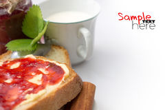 Bread with jam and milk Stock Image