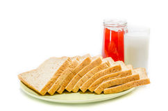 Bread with jam of milk on white Studio. Shot stock photography