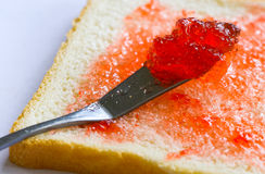 Bread and jam. Bread and strawberry jam in the morning Royalty Free Stock Image