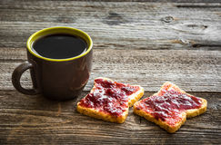 Bread with jam and tea for breakfast Stock Photo