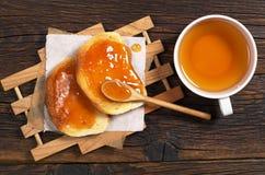 Bread with jam and tea Stock Photos