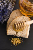 Bread and jar of lavender honey Royalty Free Stock Image