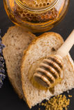 Bread and jar of lavender honey Royalty Free Stock Photo