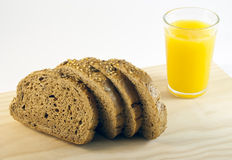 Bread and juice. Bread and orange juice on a white background Stock Images