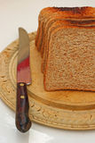 Bread and knife. Stock Image