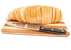 Bread with a knife Stock Photography