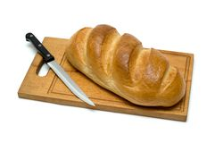 Bread with knife Royalty Free Stock Photography