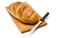 Bread with knife Royalty Free Stock Photos