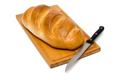 Bread with knife Stock Images