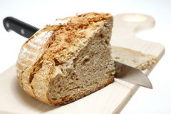 Bread with knife Royalty Free Stock Image