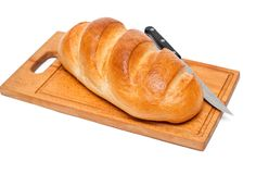 Bread with knife Stock Photos