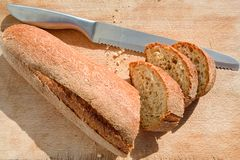 Bread knife and bread Stock Photo