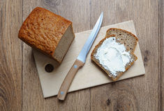 Bread. Knife and creamy butter spread over slice of stock images