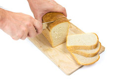 Bread with a knife on a cutting board Royalty Free Stock Photo