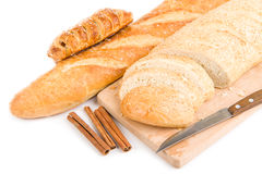 Bread, knife isolated over white Stock Images
