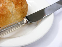 Bread, knife and sideplate. A side dish in a sophisticated restaurant Royalty Free Stock Images