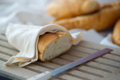 Bread and knife on table cloth Royalty Free Stock Photography