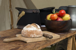 Bread and knife with tomatoes on background Stock Photography