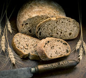 Bread knife. Bread and knife with wheat Royalty Free Stock Photography
