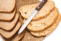 The bread and the knife. On white background Stock Photos